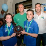 Rachael Kelly and Ben Rafferty who captained the champion Newry and Mourne team, pictured with Paul Rodgers, head coach Newry.